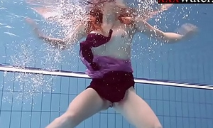 Smokin' sexy Russian redhead in be passed on pool