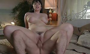 Dark haired bimbo with broad in the beam natural tits enjoys rough pounding